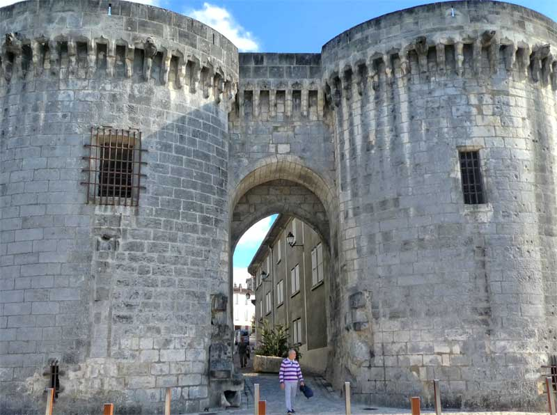 Immense stone towers on the quayside of the river Charente in Cognac