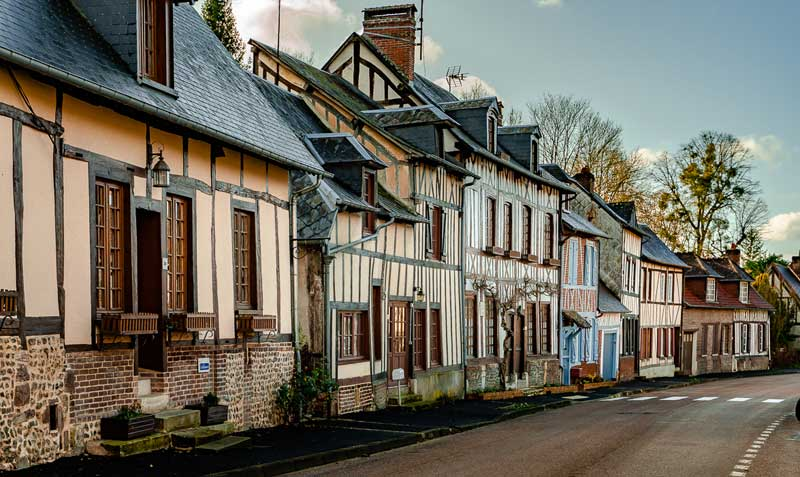 Half timbered houses in a street in Lyons-la-Foret, Normandy