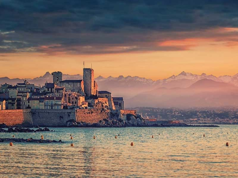 Antibes at night fall, the waves lapping up to the foot of the old fort