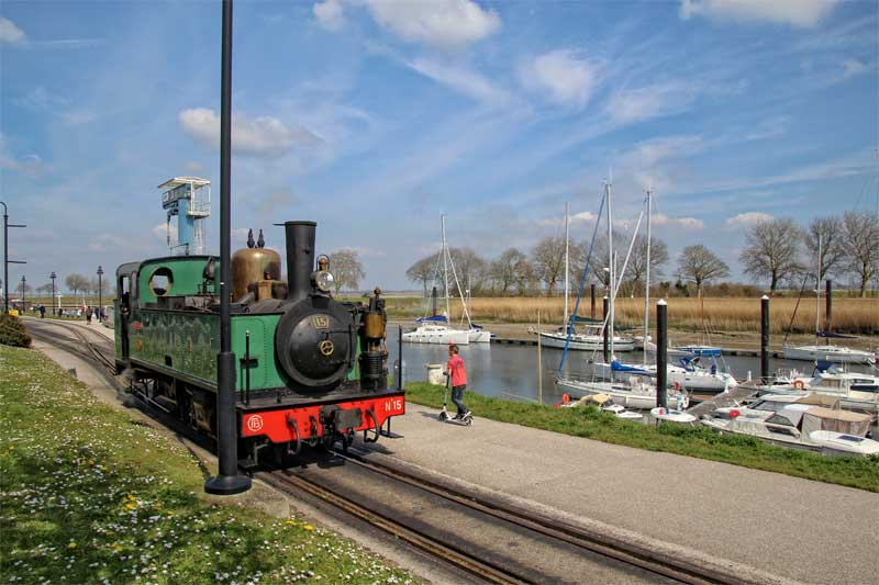 Steam train running alongside the Somme River at St-Valery-sur-Somme, Picardy