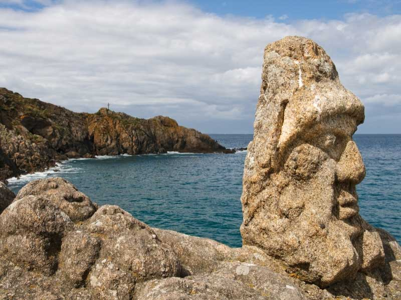 Sculpted faces and figures carved into the granite cliffs at Rotheneuf, Saint Malo