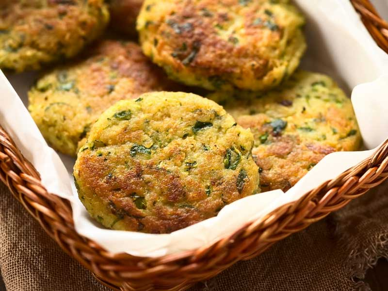 Basket of just fried zucchini cakes or courgette fritters