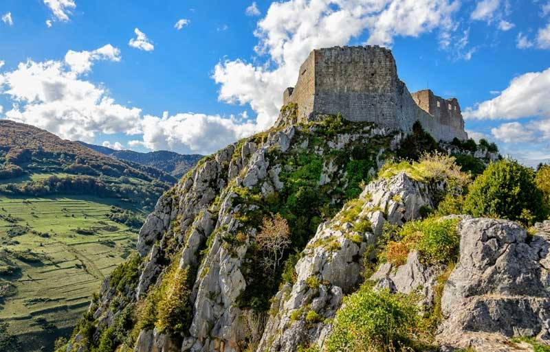 Montsegur Castle atop a steep stone mountain