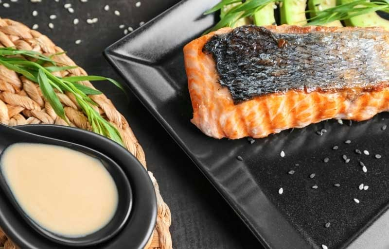 Dish with salmon and a light citrus sauce