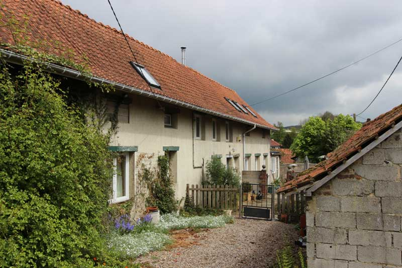 Long, narrow stone house with terracotta roof called a longere in France