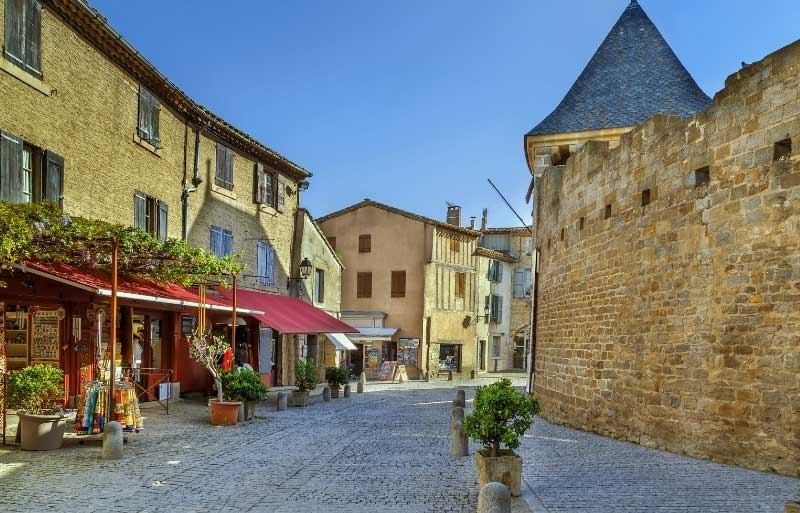 Cafes and shops on a cobbled street in the walled city of Carcassonne