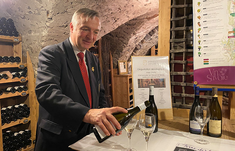 Man pours wine in an ancient cellar