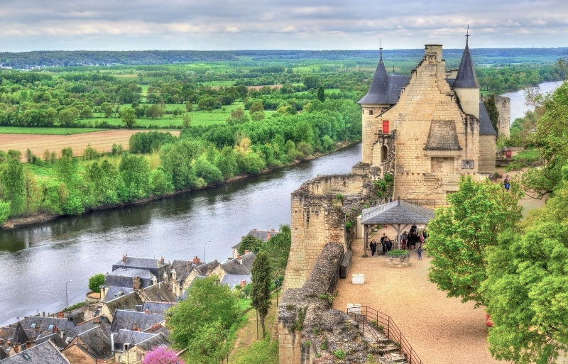Chateau and ramparts overlooking a river in Chinon, Loire Valley