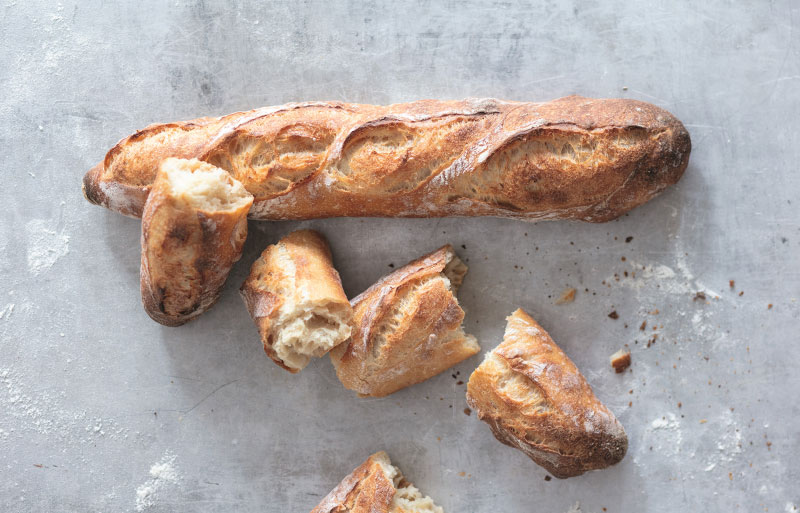Just baked, steaming French bread sticks