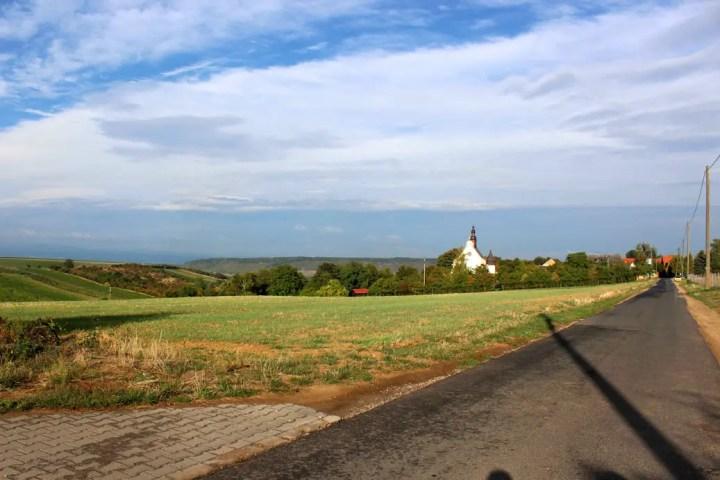 Meadow and village church near Gau-Algesheim
