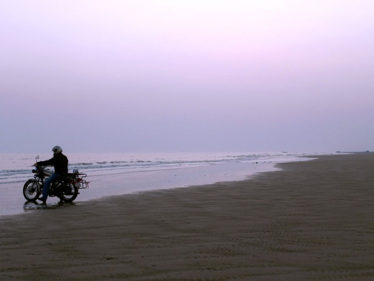 Bike on the beach at sunset in Mandarmoni, West Bengal, India - travel mistakes we made