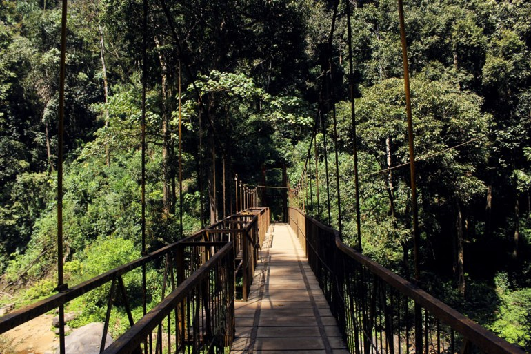 Bridge across the river at Abbey falls near Madikeri, Coorg, Karnataka, India - travel mistakes we made