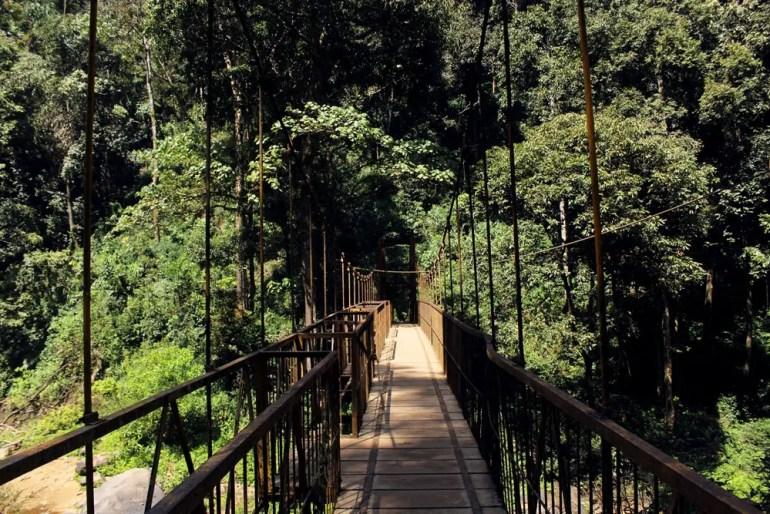 Bridge across the river at Abbey falls near Madikeri, Coorg, Karnataka, India - travel mistakes we made