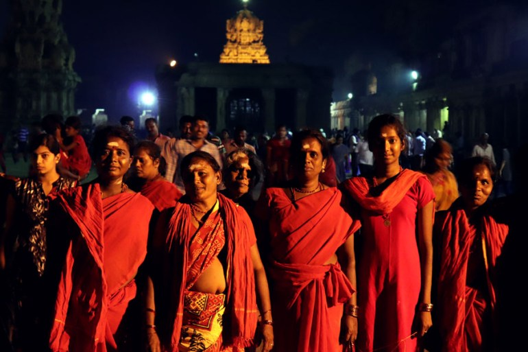 Thanjavur - Ladies in red - Temples of Madurai and Thanjavur