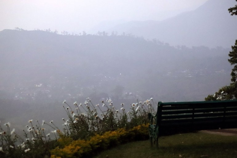 Bench with a hilltop view at Sinna Dorai's Bungalow, Valparai, Tamil Nadu, India - an escape from the summer heat