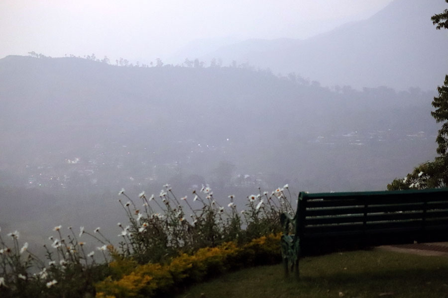 Bench with a hilltop view at Sinna Dorai's Bungalow, Valparai, Tamil Nadu, India - winter holiday destination