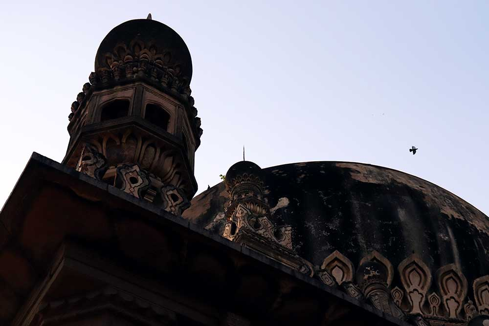 minaret and dome of abdullah qutb shah's tomb, qutb shahi tombs, hyderabad, india