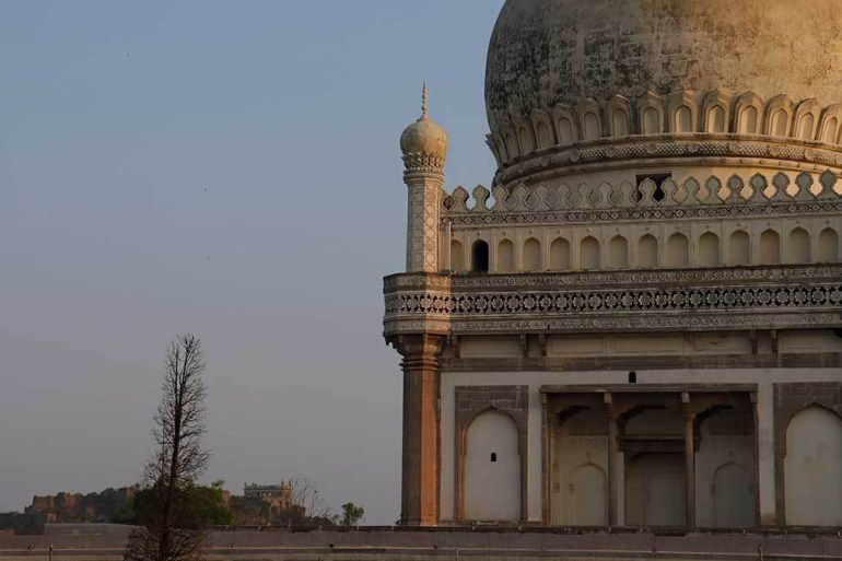 tomb of muhammad quli qutb shah with golconda fort in background, qutb shahi tombs, hyderabad, india