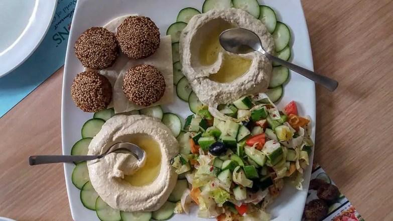 Veg mezze platter at All Seasons, Hyderabad, India. Falafel, pita bread, mouttabel, fattoush, hummus