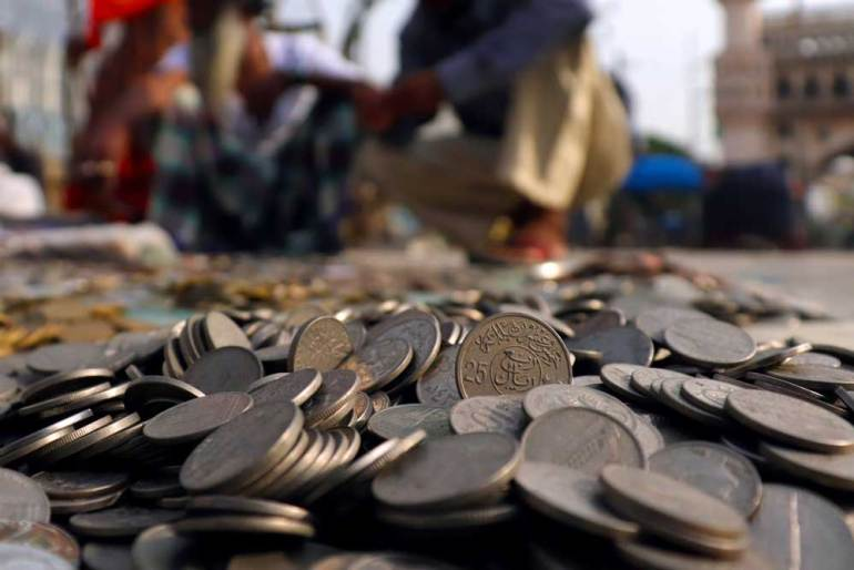 Antique coins on sale by the roadside behind Charminar