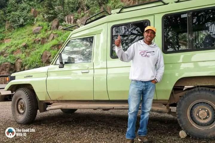 Driver and landcruiser, Kenya safari