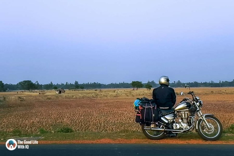 Biker in fields - Motorcycle touring tips