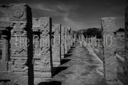 Carved granite pillars on the courtesans' street in Hampi