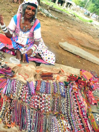 A banjara gypsy shows off her wares