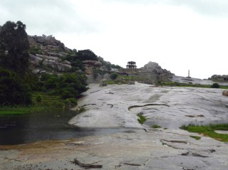Stone stairs carved into the bedrock and leading through a rain-fed rivulet