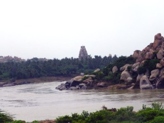 The Virupaksha temple stands guard over the swollen river