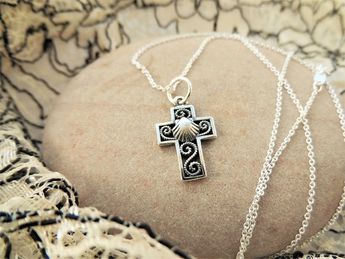 Christian cross with shell