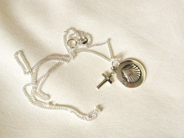 Scallop shell cross necklace to stay safe