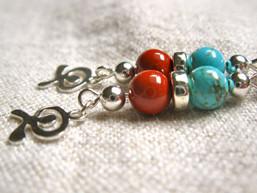 Indalo earrings for protection, health
