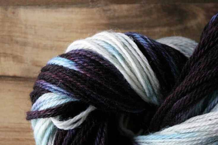 Wrapped skien of yarn showing dyed variegation.