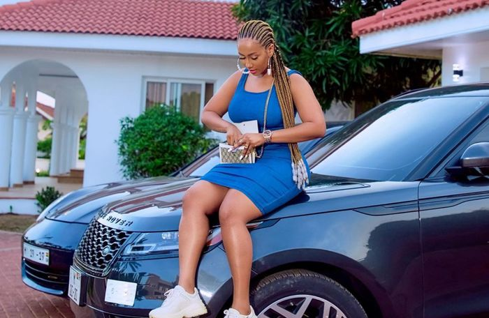 PHOTO: Hajia4Real Flaunts Her Rented Mansion And Expensive Cars On Instagram