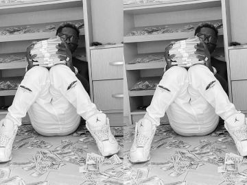 Shatta Wale Surrounds Himself With Fake Dollar Bills In New Photo?