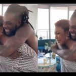 VIDEO: Burna Boy's Mum Carries Him On Her Back Like A Baby As He Celebrates His 30th Birthday