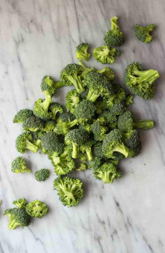 Broccoli on marble board.