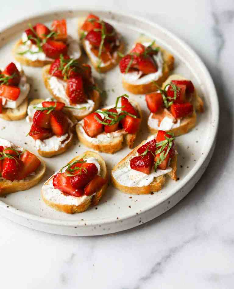 Strawberry basil bruschetta on a white plate