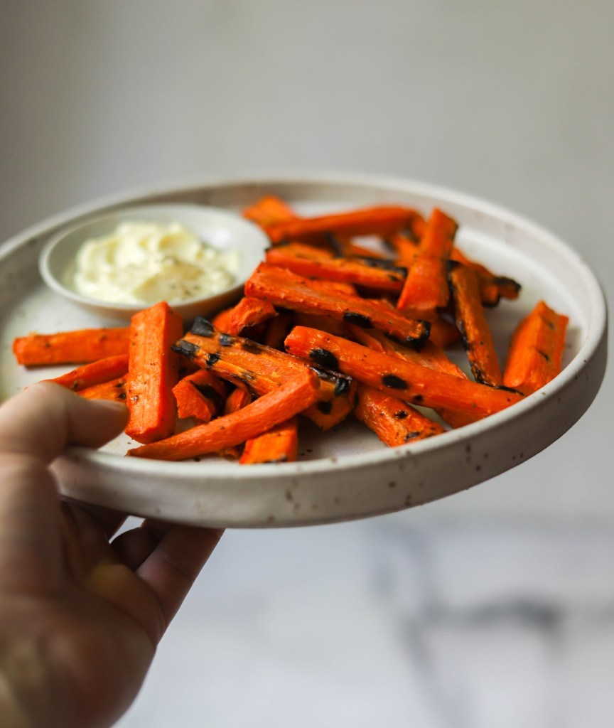 Grilled carrot fries on a stone plate