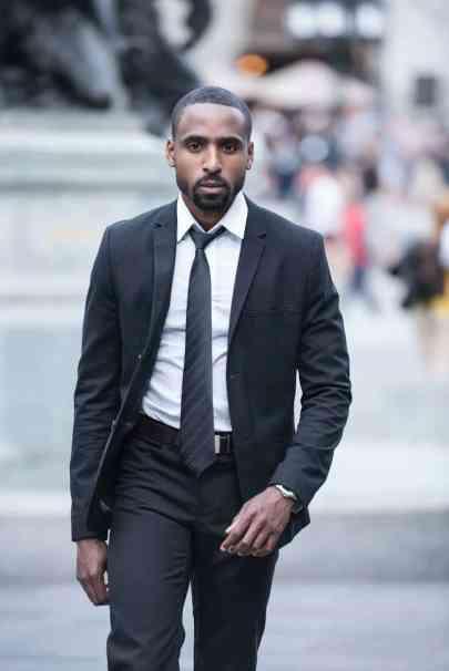 man wearing black suit