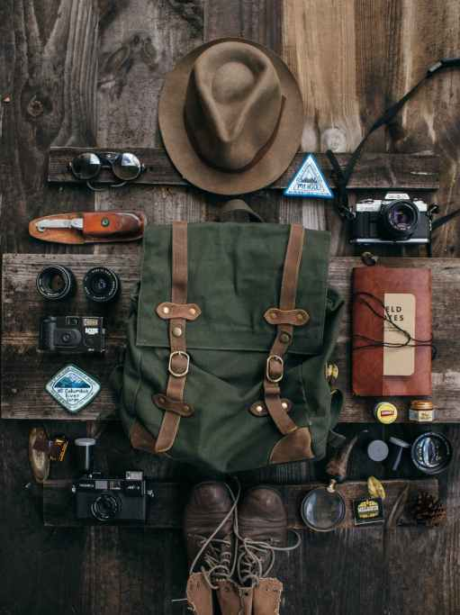 various objects for expedition with retro cameras on desk