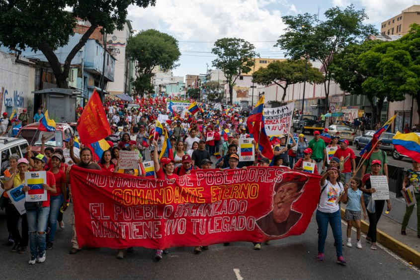 Venezuela no more Trump march Chavez banner