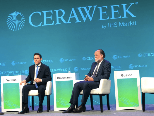 Hausmann and Vecchio at IHS Markit's special dialogue week, with an empty chair signifying Guaido
