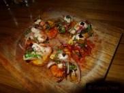 Galician Octopus on Paprika Potatoes with Black Garlic, Herbs, Spanish onion & Sherry Vinegar