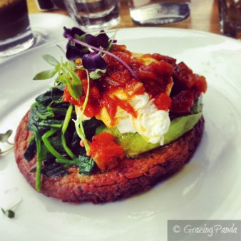 Beetroot, zucchini and haloumi fritter, avocado, spinach, poached egg, tomato relish