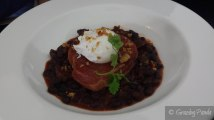Black Beans, Chorizo + Otway Pork served with garlic crumbs + a poached egg