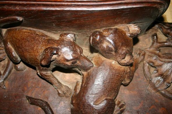 Misericord St.Andrews Cathedral,Wells,UK 14th Century Puppy Attacking a Cat, Cat in Church Architecture, Medieval cats