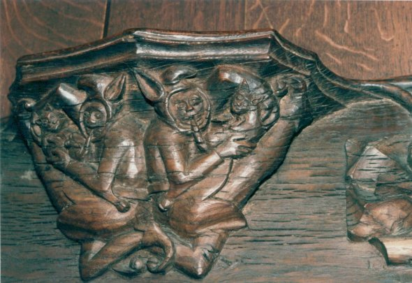 Misericord 14th Century St.Bolophes, Boston Two Jesters Biting , Cat in Church Architecture, Medieval cats