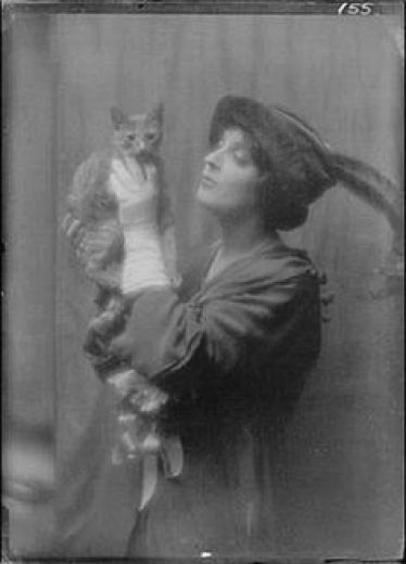 Woman with a Feather Hat with Buzzer the Cat 1910